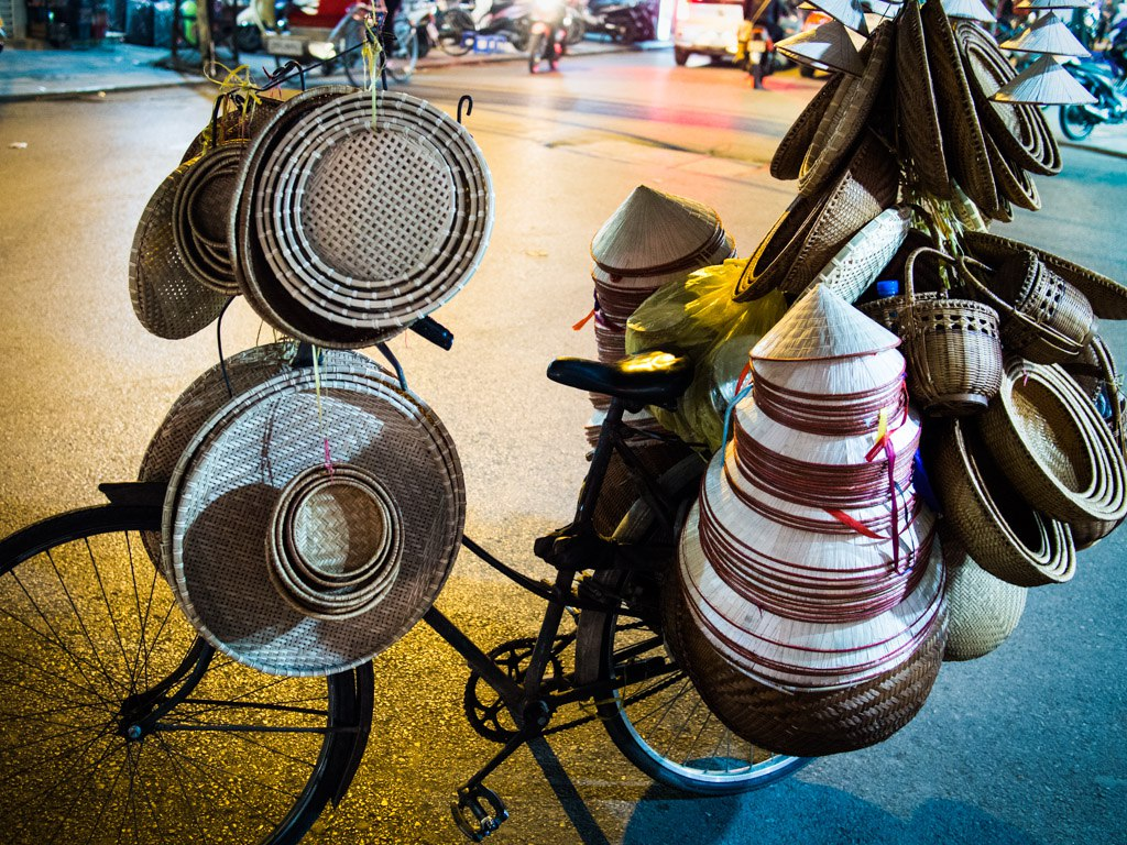 bicycle loaded with vietnamese hats in hanoi