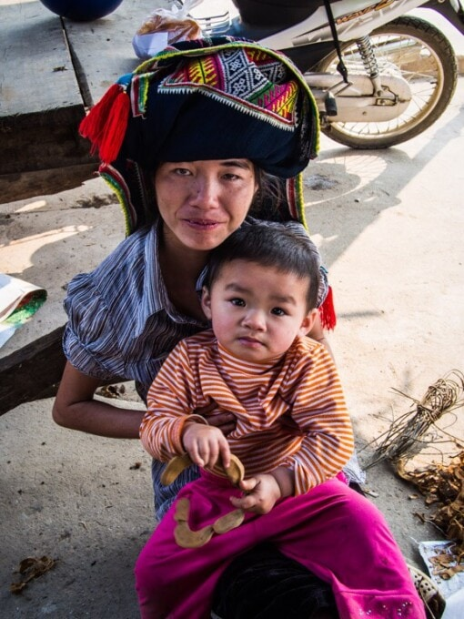 woman and child traditional head dress vietnam