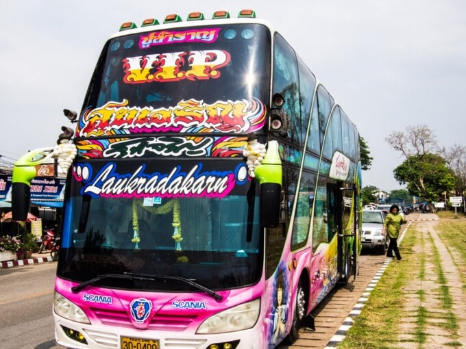 brightly colored vip bus in thailand