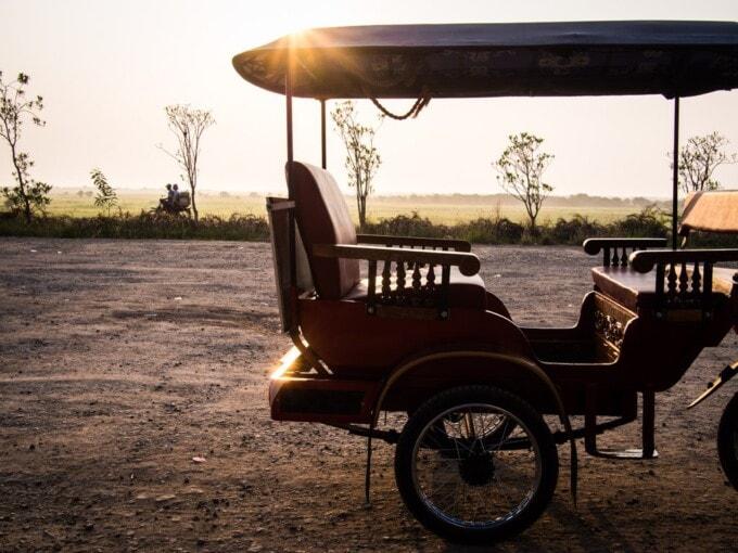 cambodian tuk tuk at sunset