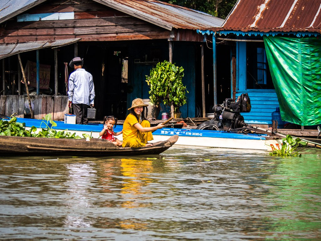 Waving to the ferry boat, floating village near Tonle Sap.