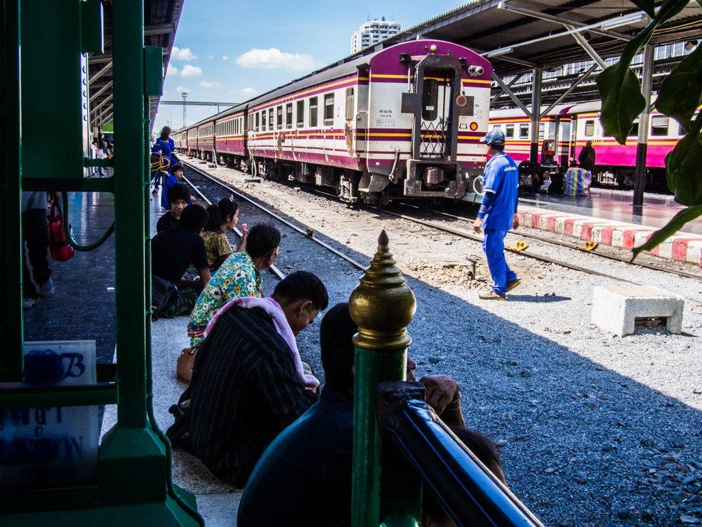 Sitting on the platform, Bangkok Railway Station.