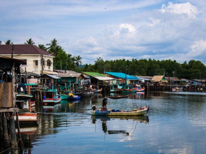 small boat and stilt houses in mae rut thailand near cambodia border