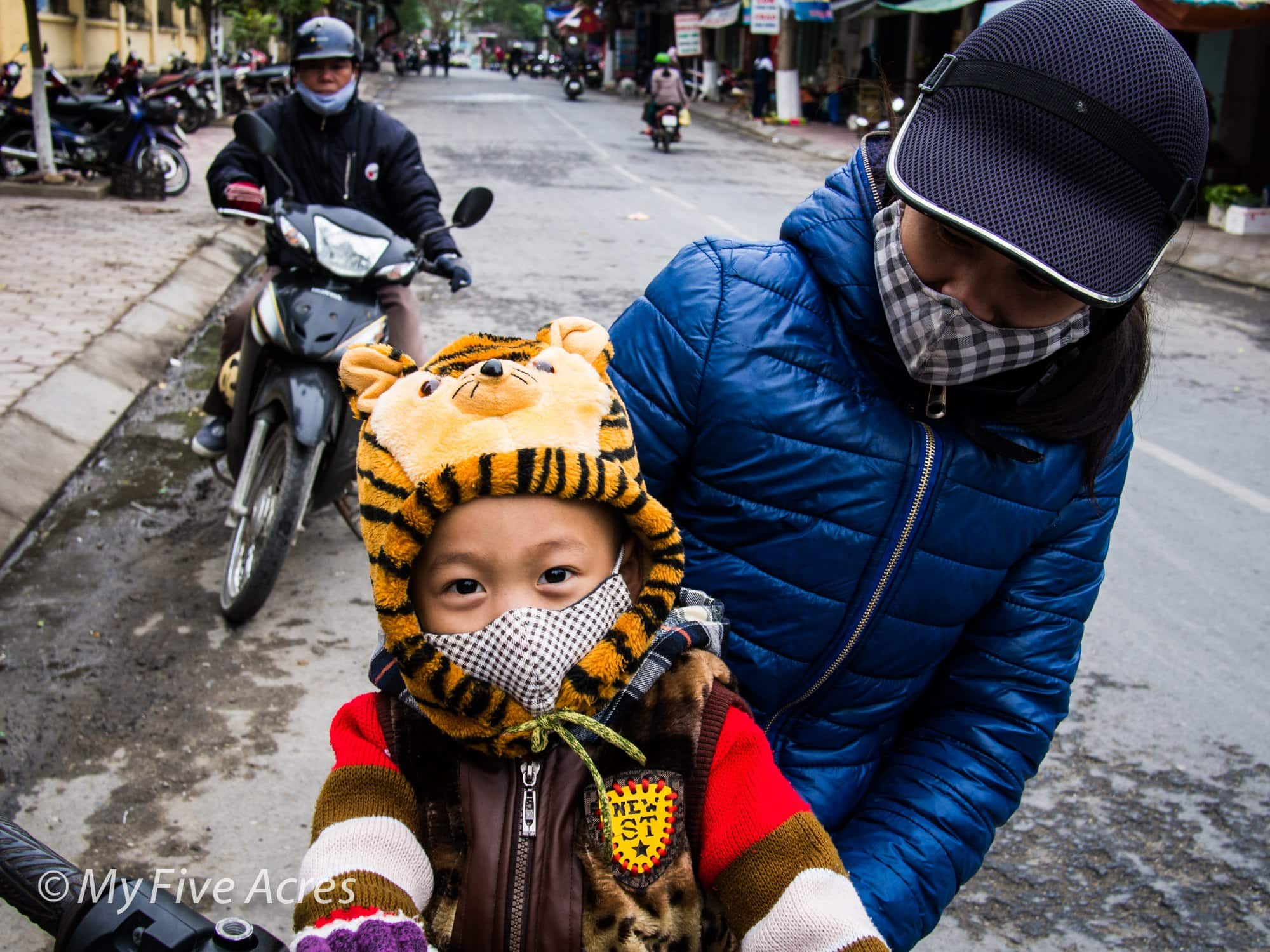 Kid on a motorbike - Vietnam Travel Photos