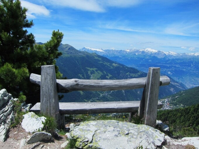 wooden bench with endless views of the alps in zinal