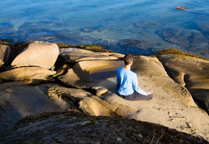 stephen meditating on the seashore in canada
