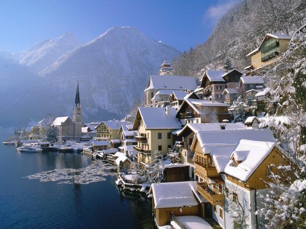 snowy houses on lake in hallstatt austria