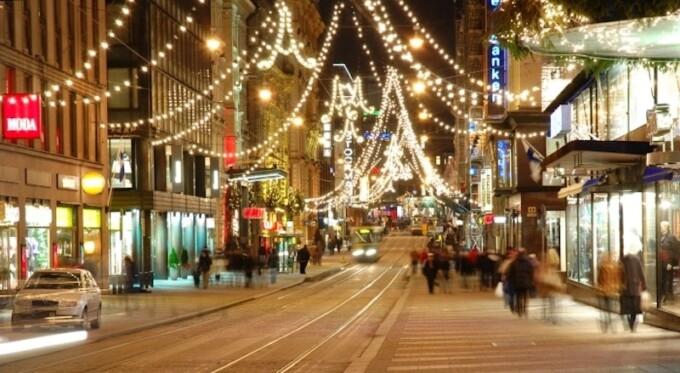 christmas lights strung over a street in helsinki finland