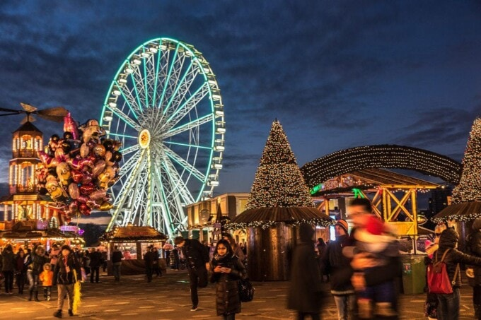 christmas fair in london with london eye in fairly lights