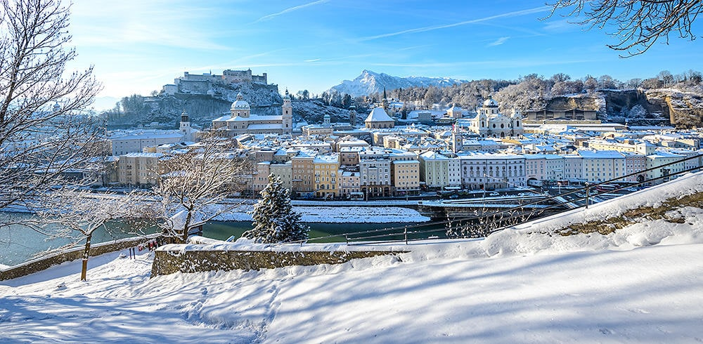 snow park and city in salzburg austria