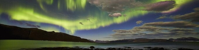 northern lights over water in tromso norway