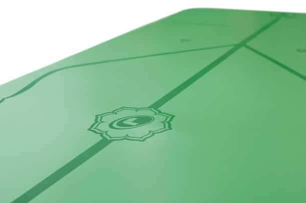 green liforme yoga mat with alignment marks