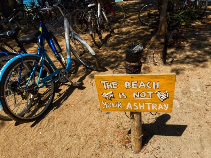 sign that says this beach is not your ashtray on a gili island beach