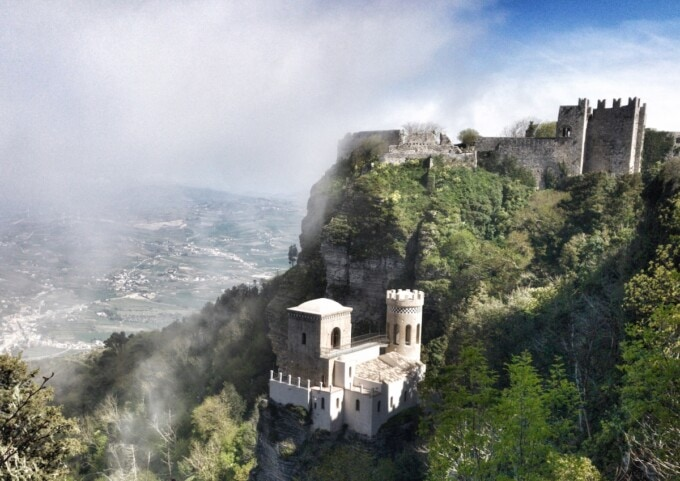 mist descends over a hilltop castle in sicily italy