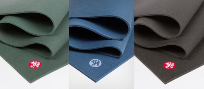 green blue and brown yoga mats by manduka