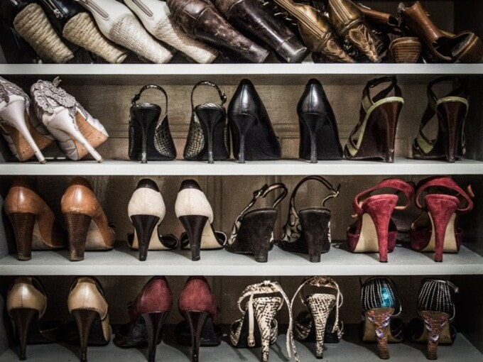 dozens of high-heeled shoes in a closet