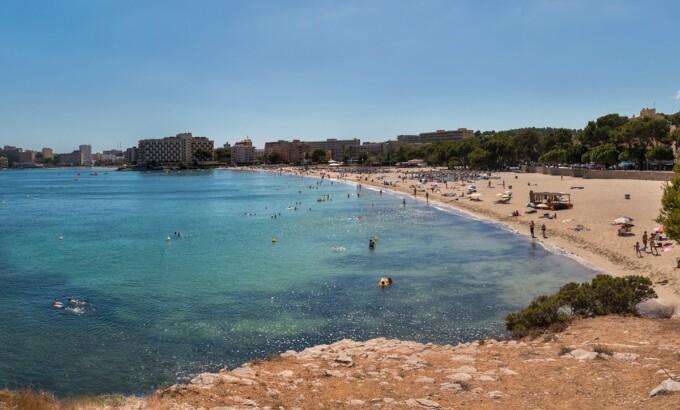 people swimming in a bay in Palma de Majorca, Spain