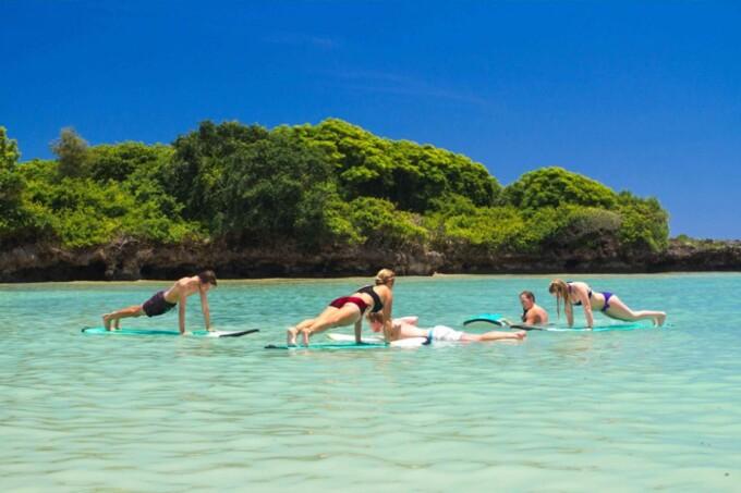 people doing sup yoga at mondo surf bali