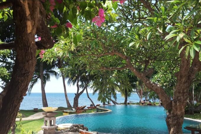 pool overlooking the ocean at puri bagus lovina