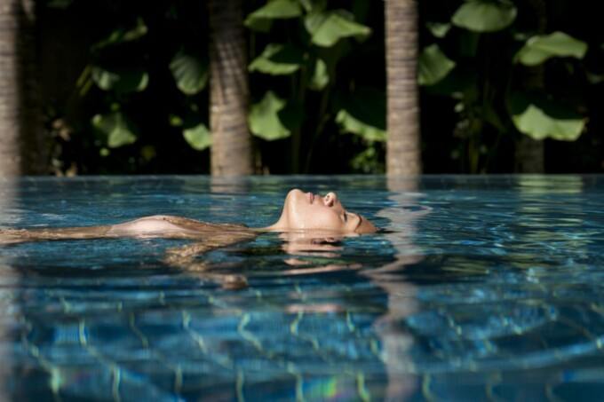 woman relaxing in the pool at bali revivo