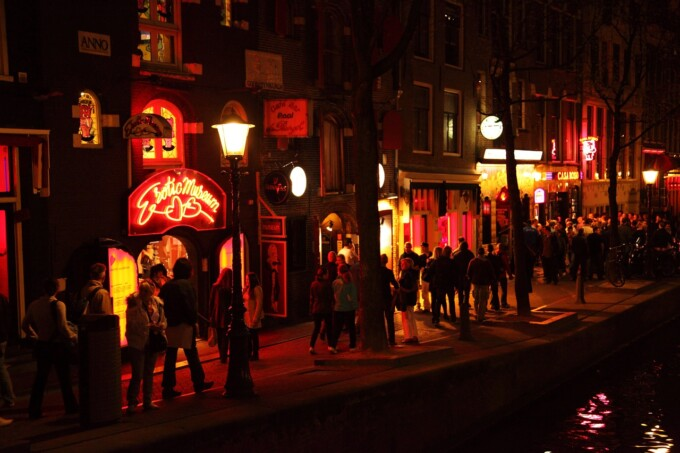 night photo of amsterdam's red light district