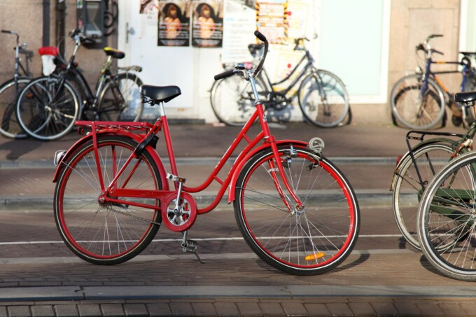 red bicycle on the streets of amsterdam