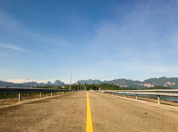 empty road on thailand cycle tour