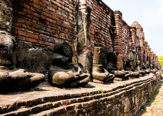 rows of headless buddha statues at Ayutthaya