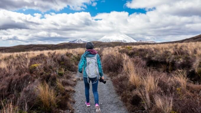woman hiking towards distant mountains