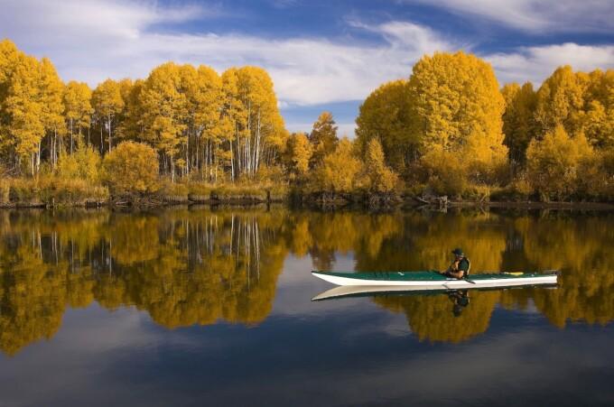 ecotravel kayaking on smooth lake