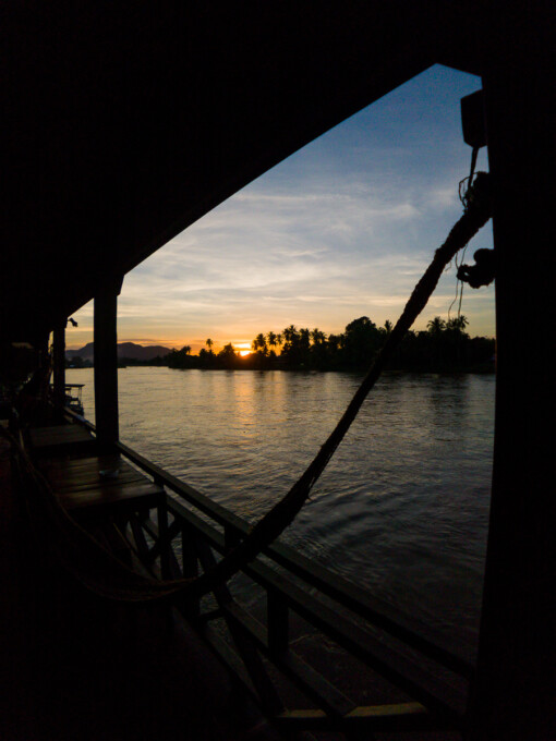sunset over water from a hotel balcony 4000 islands laos
