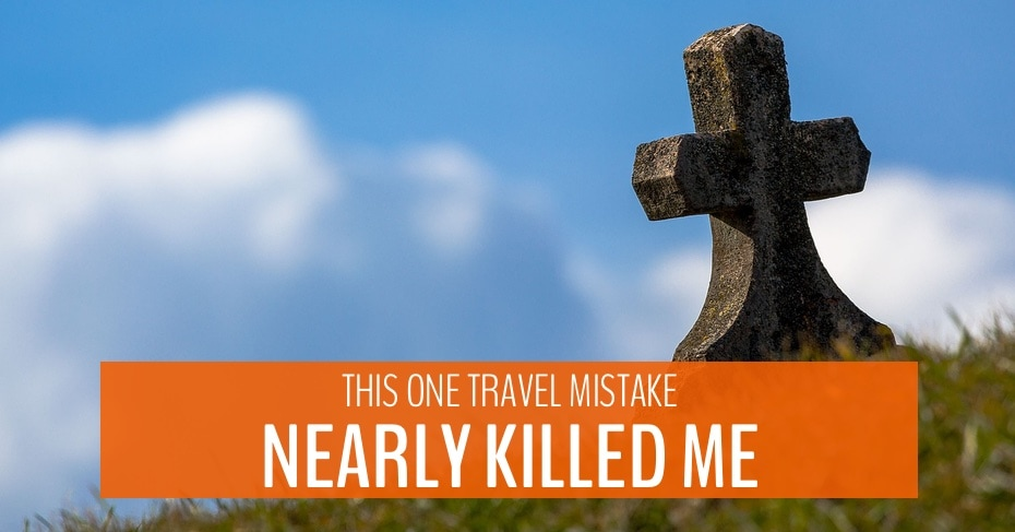 stone cross on a hill overlay text this one travel mistake nearly killed me