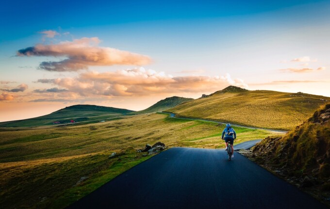 man on bicycle in empty landscape ecotravel