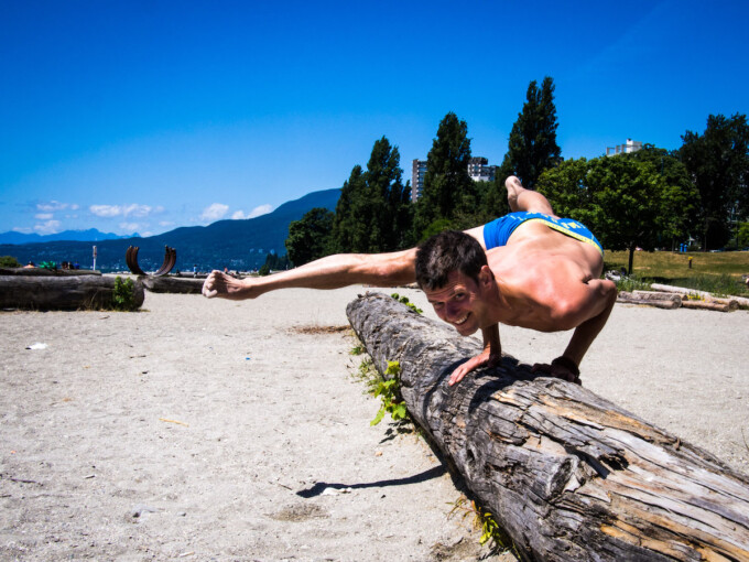 stephen doing yoga on the beach in vancouver bc