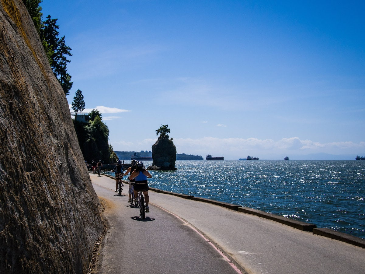 cyclists on the seawall in vancouver on the west coast canada