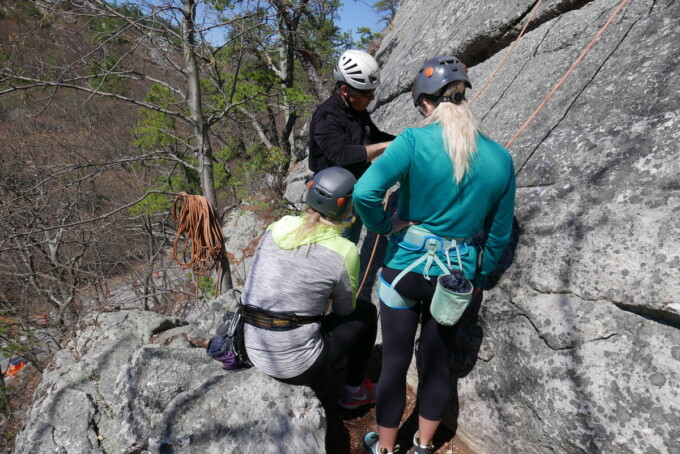 women learning how to rock climb
