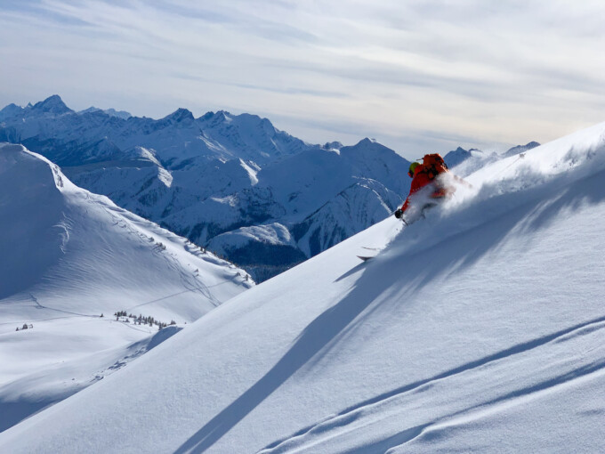 person backcountry skiing on beautiful mountain slope