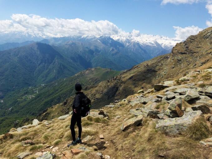 man hiking in Gran Paradiso national park italy