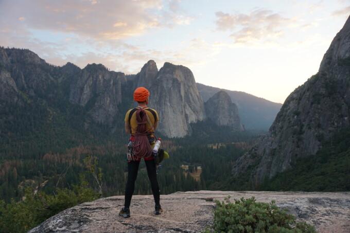 man viewing mountains after rock climbing