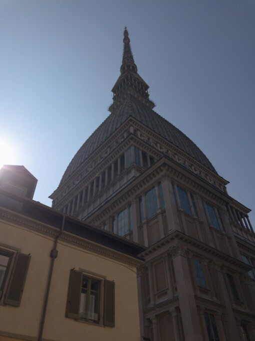 sun glinting off the mole tower in turin italy