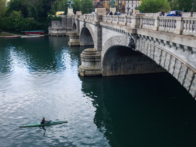 kayaker on po river in turin italy