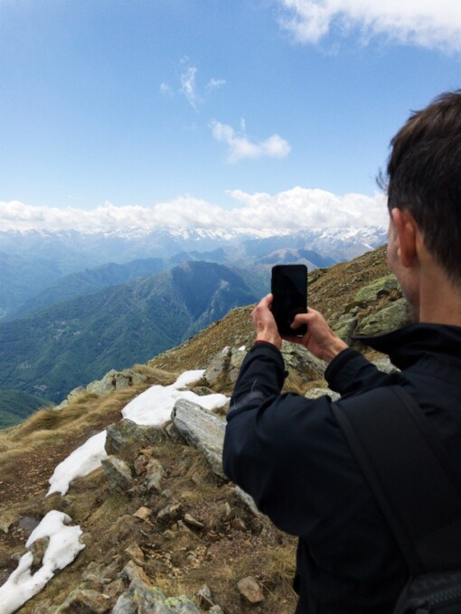 stephen taking a picture of the alps