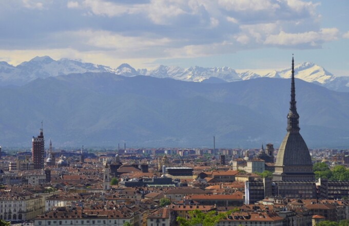 city of turin with alps in the background