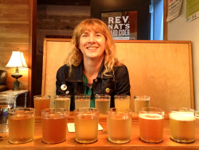 the author with a giant cider tasting flight from reverend nats