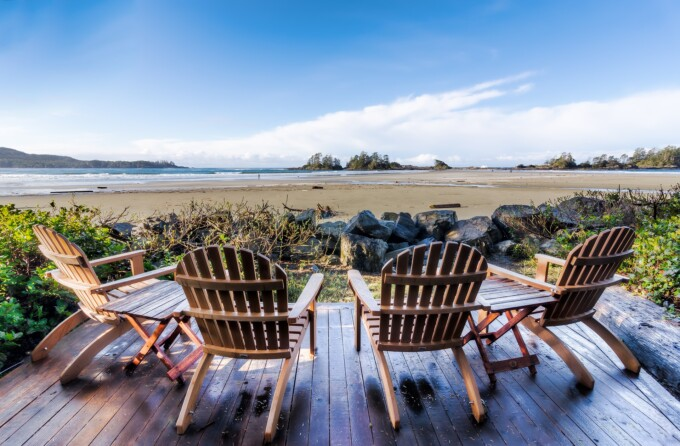 beach chairs overlooking a wide sand bea