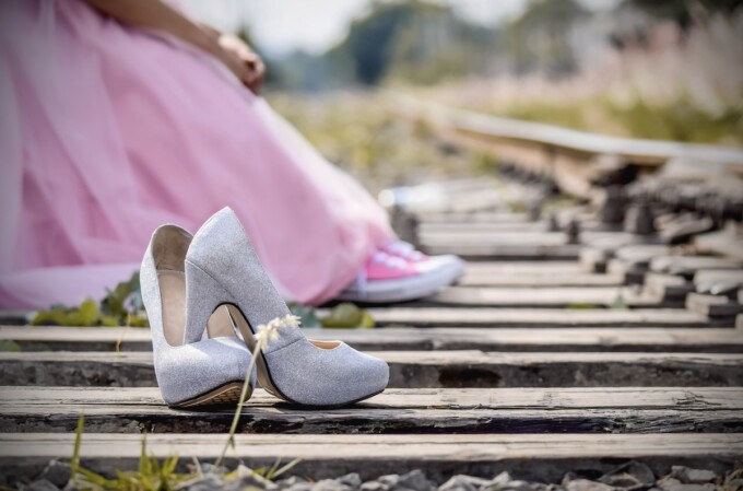 pair of high heels abandoned on a railroad track