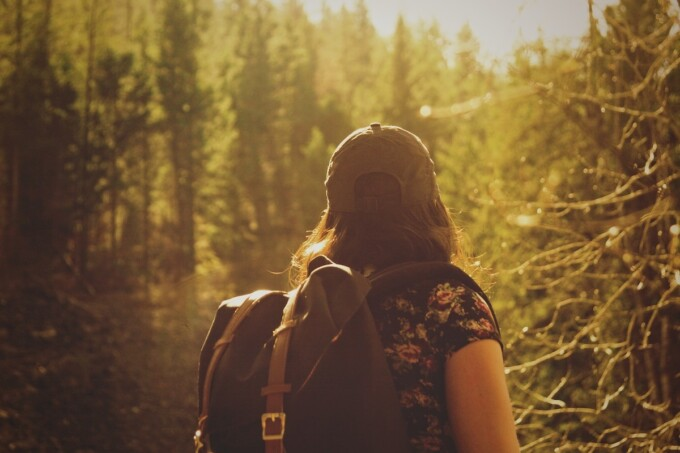 Woman hiking in the woods with backpack