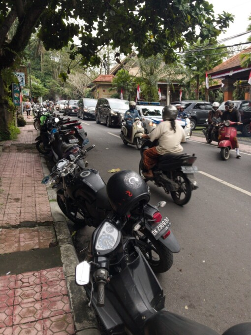 parked motorbikes on the street in bali