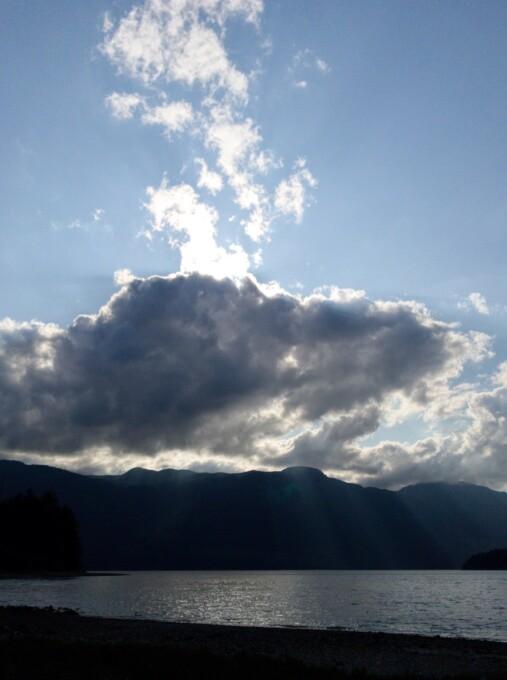 sun shining through clouds in british columbia