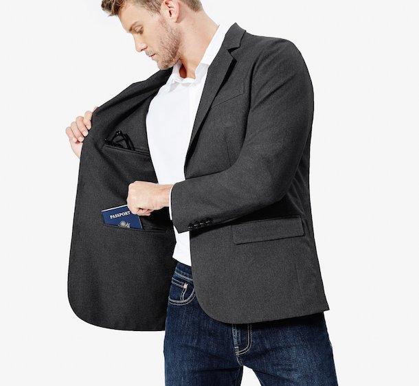 man putting a passport in his blazer pocket